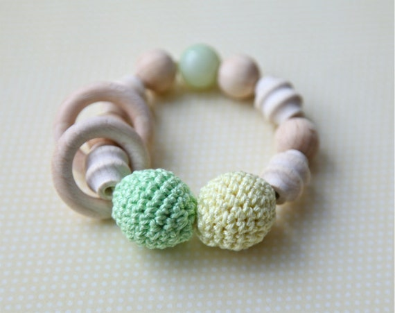Teething toy with crochet green/ mint, light pale yellow wooden beads and 2 wooden rings. Wooden rattle. Teething ring