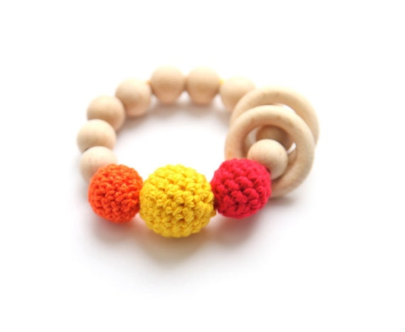 Teething toy with crochet red, orange and yellowt wooden beads and 2 wooden rings. Wooden rattle. Gift for baby and mum.