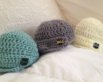 Hand knit Newsie/Newsboy Baby Hat with Train button