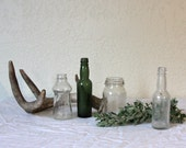 Collection of small vintage glass bottles