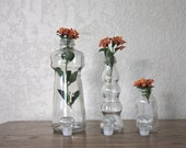 Collection of 3 Clear Glass Bottles