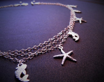 BODEGA BAY wants to go out and play. Sterling silver chain and silver charms.