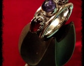 The Oath-Ring of Jupiter...OOAK Handmade Sterling Silver and Gold alloy (Electrum) Large ring set with iolite and teardrop garnet cabochons - TheSilverCrucible
