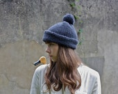 Classic hand knitted wooly pom pom hat in charcoal grey