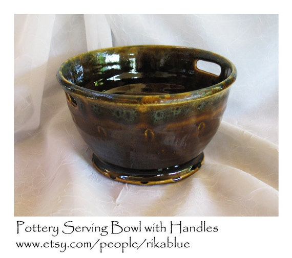Brown pottery bowl with handles