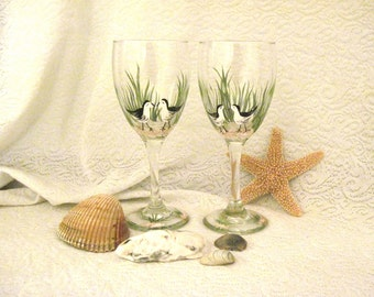 Birdies on the beach hand painted pair of wine glasses