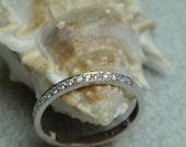 Ladies 14kt white gold and diamond wedding band