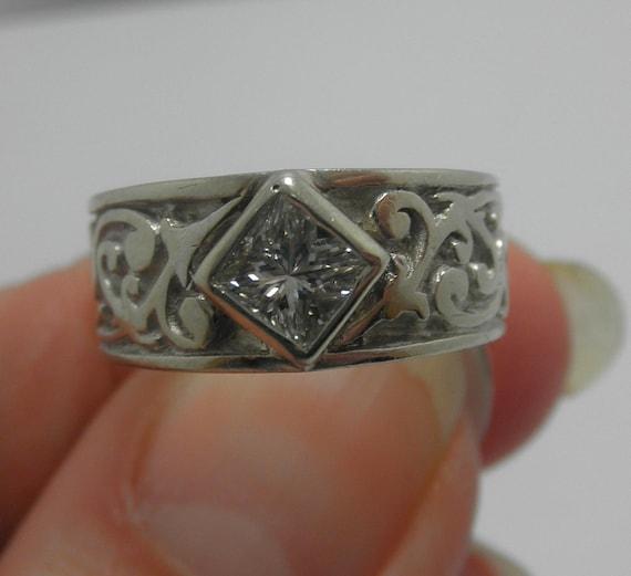 One of a kind Princess Diamond wide band  single stone is 85 point  custom  Bezel set ring
