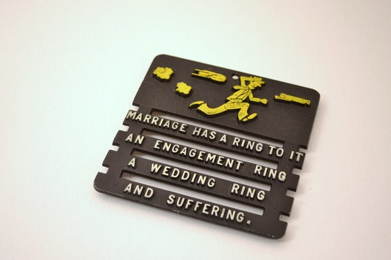 Quirky wedding gift : trivet with kitschy message about marriage