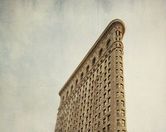 Flatiron Building NYC photo new york city landmark manhattan architecture skyscraper brown blue renaissance beaux-arts