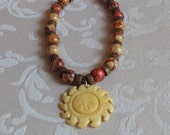 Bone Carved Sun Pendant on Wood and Greek Leather Necklace