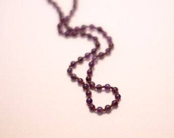 Amethyst necklace hand knotted on brown silk