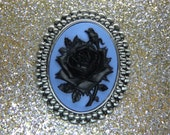 Beautiful Goth Black Rose on Vibrant Blue Background Cameo Brooch
