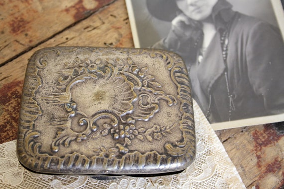 Antique card case with italian alpine flower.