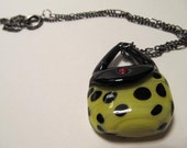 Necklace with lampwork purse bead
