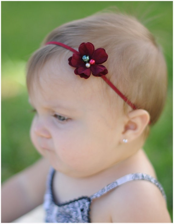 Ready to ship Christmas flower headband in velvety dark red with pearl center on skinny elastic great photo prop