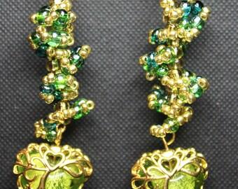 Green and gold dangling heart earrings.