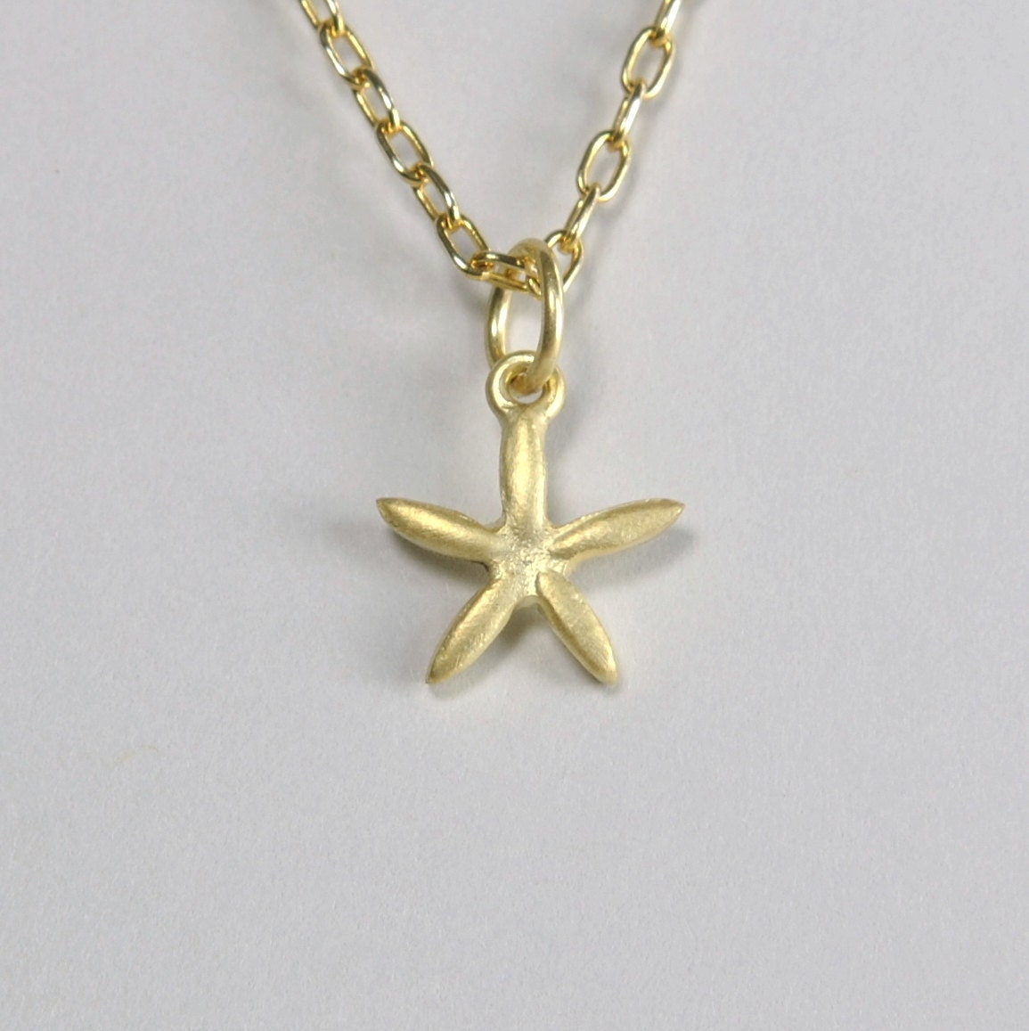 solid 14k gold starfish pendant