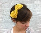 Mustard-yellow handknit bow