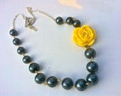 Blue pearl necklace with a yellow rose pendant