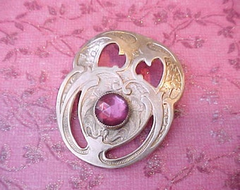 Gorgeous Arts and Crafts Era Brooch with Huge Raspberry Colored Faceted Cabochon