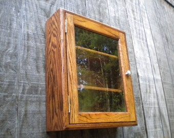 Solid oak wall display glass curio cabinet