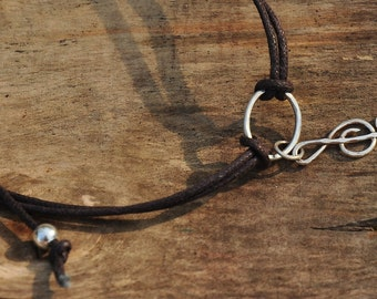 Friendship bracelet with sterling silver handmade treble clef charm