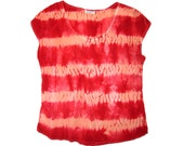 Shibori tie-dyed silk blouse in peach and red