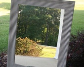 Houndstooth covered mirror