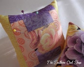 Yellow, purple and peach courtyard steps quilt block pin cushion