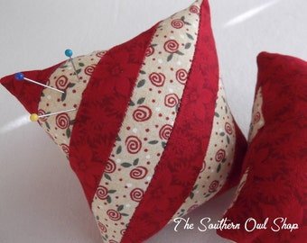 Diagonal stripe pieced quilt block in red and tan pin cushion