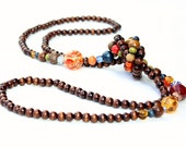 Long dark brown wood knotted rope necklace, amber, blue and red highlights, boho, funky
