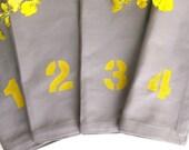 number dinner napkins serviettes, grey cotton fabric, yellow hand printing, set of 4, gray, mustard yellow