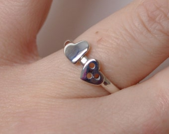 Handmade silver ring with two hearts in a UK size M only.