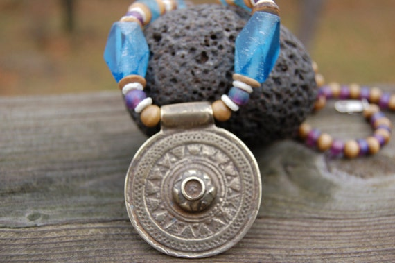 African necklace with brass shield, recycled glass bead, ostrich shell beads and wooden beads 24 incles