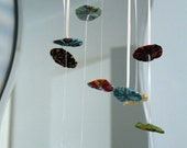 Fabric Button Mobile, each button is created from various fabrics of different colors and patterns