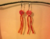 Pink, yellow, orange, and red embroidery floss and beaded earrings
