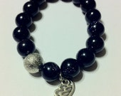 Flying at Twilight Blue Goldstone Beaded Bracelet with Angel Wing Charm