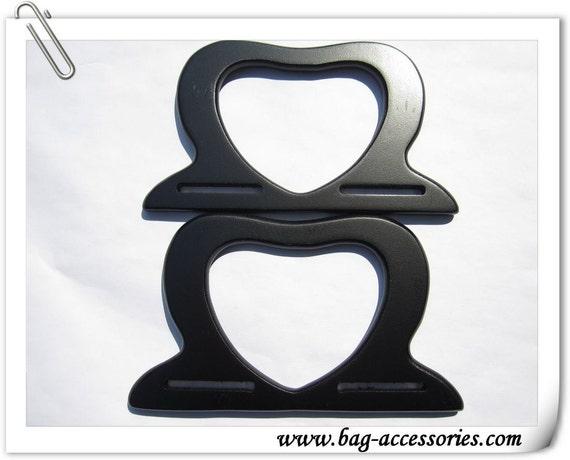 "A pair of black heart shape wooden handles, 7"" X 4"""