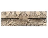 Camel clutch in genuine recycled python