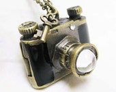 black camera locket necklace with a little lovely key charm
