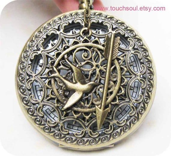 The Hunger Games Inspired Arrow with Mockingjay and Peeta Pearl heart spider web pocket watch locket necklace