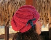 Hand-knitted hat with leaves