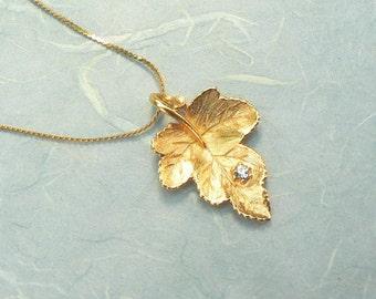 Goldtone Leaf Pendant Necklace with Rhinestone
