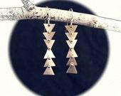 follow earrings in sterling silver