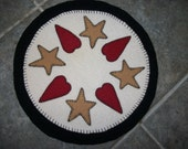 Wool table mat with heart and stars