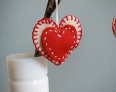Three red and cream felt heart Valentine's day ornaments