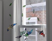 Flying Birds Mobile, four multi colored stained glass birds floating under leaf covered branches