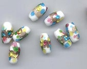 Nine rare and beautiful vintage Japanese lampwork glass beads - 16 x 8 mm ovals with a band of matte gold foil and splatters of color