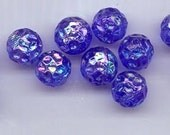Twelve vintage West German glass beads - 11.5 mm round transparent cobalt blue dimpled beads with an AB flash